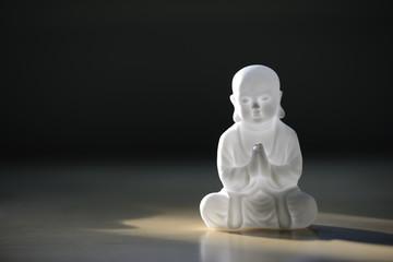 plastic small buddha sculpture