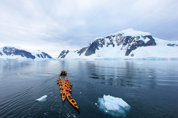 Beautiful colourful kayaks on the blue ocean, Antarctic Peninsula, Antarctica