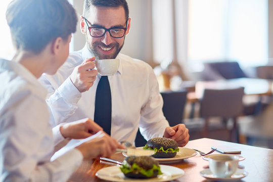 Business people interacting by lunch in restaurant