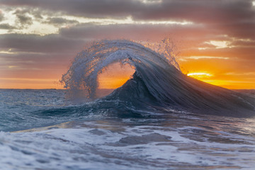 Ocean wave at dawn