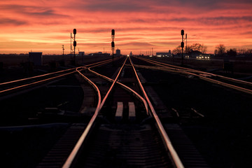 Colorful sunset illuminating train tracks