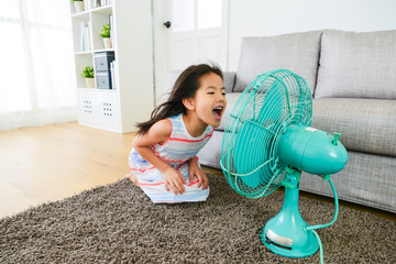 lovely young female children face to electric fan