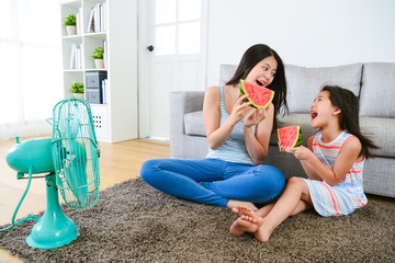 happy woman and female children holding watermelon