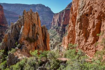 North Kaibab trail passing through red llimestone walls of Roaring Springs Canyon North Rim, Grand Canyon National Park, Arizona, USA