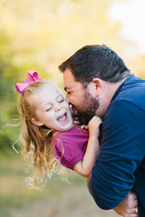 Daddy and his little girl playing in the park