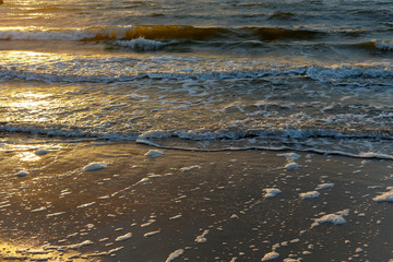 Gentle waves of the Baltic Sea at sunset
