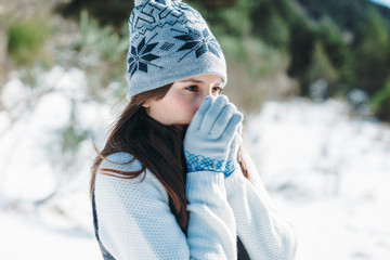 Closeup of a young woman on a cold snowy day.