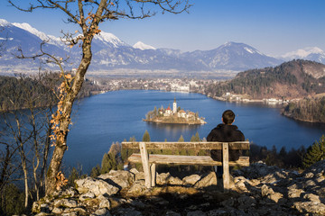 Sitting on the bench with a view of lake Bled.