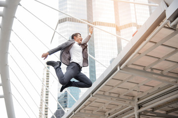 Businessman happily jumping, Business concept, Lifestyle concept