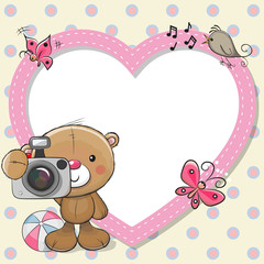 Teddy Bear with a camera and a heart frame
