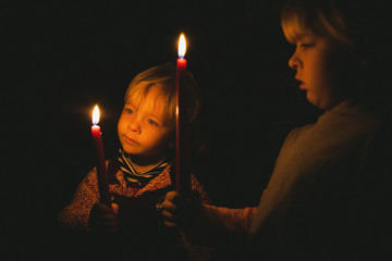 Two children with candles.