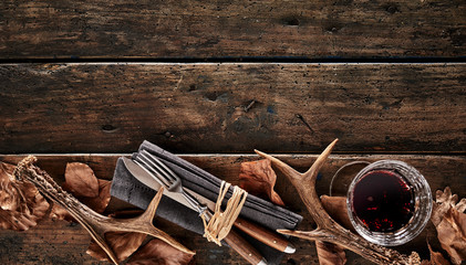 Antlers, whiskey and cutlery rustic seasonal theme