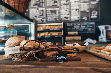 Freshly Baked Buns and Cookies Displayed on Rustic Bakery Counter