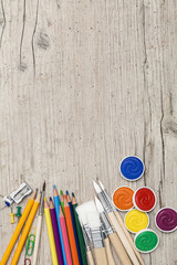 school accessories on a light wooden background