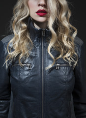 blond with red lipstick in a blue leather jacket