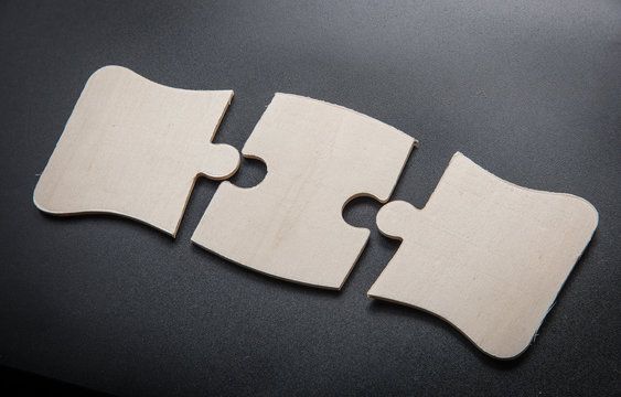 Three pieces of a puzzle with Text Space,wooden puzzle.