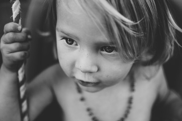 Black and white shot of small child with freckles