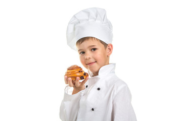 Little happy chef holding delicious tasty raisin bun with a golden crust