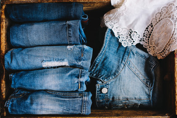 Selection of blue denim clothing with a lace shirt