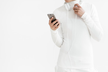 Woman In White Clothing Checking Smartphone