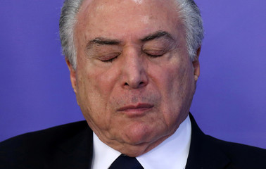 Brazil's President Michel Temer reacts during a ceremony at the Planalto Palace in Brasilia