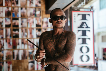 Thai tattoo artist inside his tattoo studio