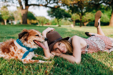 Woman relaxing in a park with her dog