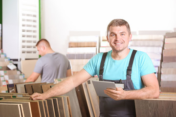 Carpenter searching for materials in hardware store