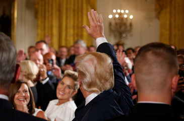U.S. President Trump greets guests during event with small businesses in the East Room of the White House in Washington