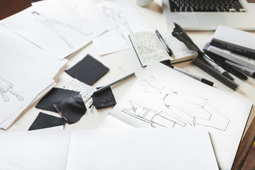 Fashion Sketches and Textiles Equipment on a Desk