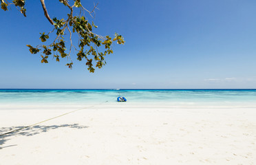 dinghy anchoring on a tropical beautiful beach