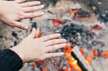 Warming hands over fire