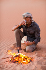 Man cooking in the desert