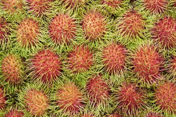 Rambutan Stacked At A Fruit Market Stall