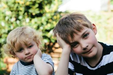 Toddler imitates his older brother