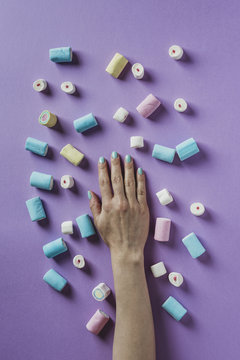 Hand with marshmallows