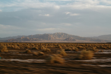 southwest landscape blurring by in car during road trip