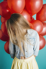 Girl with red baloons