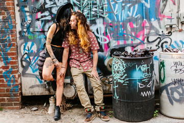 Two graffiti artists hanging out in an alleyway