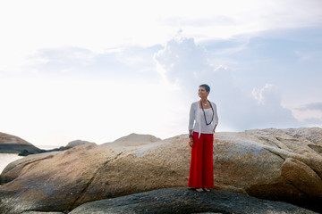 Senior Woman Standing on a Rock