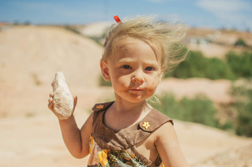 Little girl dusting for fossils