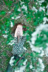 Woman lying under apple tree
