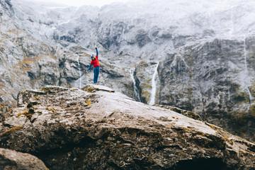 A man climbs a beautiful mountain landscape in New Zealand