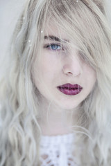 Young beautiful woman with grey hair, blue eyes and red lips