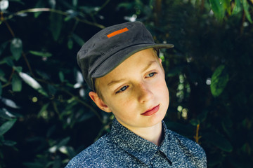 Teenage boy, outdoors, looking away from camera