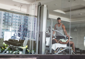 Two People Exercising in the Gym