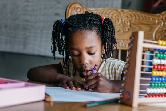 Black girl working on her homework