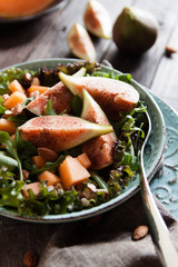 Delicious salad with cantaloupe melon and figs