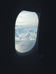 Clouds viewed from an airplane porthole