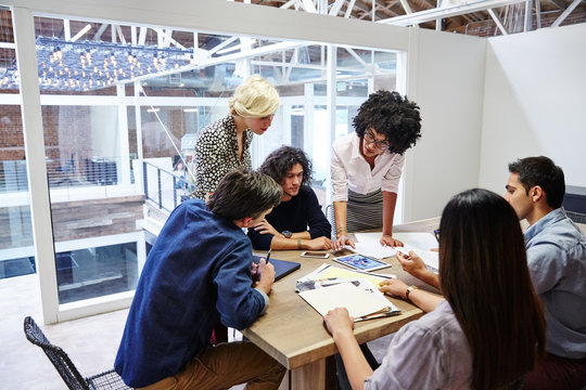Group of millennials in meeting in boardroom